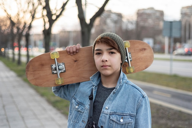 Teenage boy with skateboard