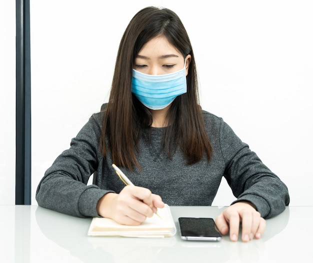 Teenage female student preparing for learnning at home