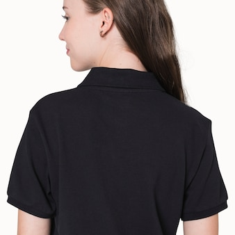 Teenage girl in black polo t-shirt for sporty youth fashion shoot