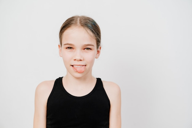 A teenage girl in a black t-shirt with collected hair