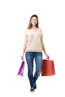Teenage girl carrying colorful shopping bags