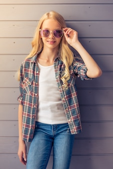 Teenage girl in casual clothes and sun glasses.