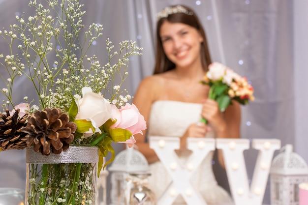 Teenage girl celebratingquinceañera with cute arrangement