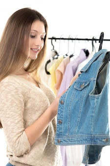 Teenage girl chooses clothes