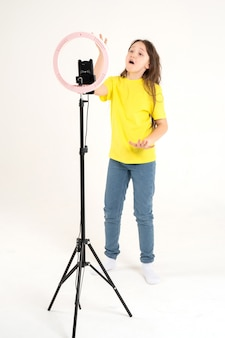 A teenage girl dances and shoots a video