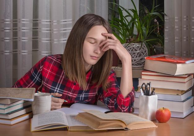 Teenage girl is doing her homework