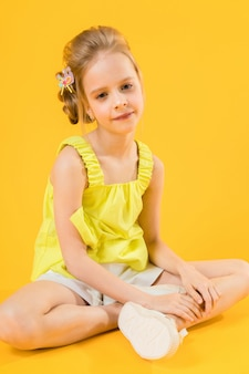 A teenage girl is sitting  a yellow  .