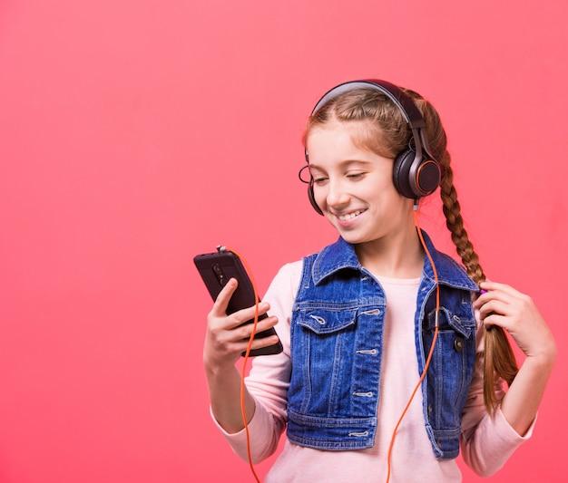 Teenage girl listening to music in big headphones