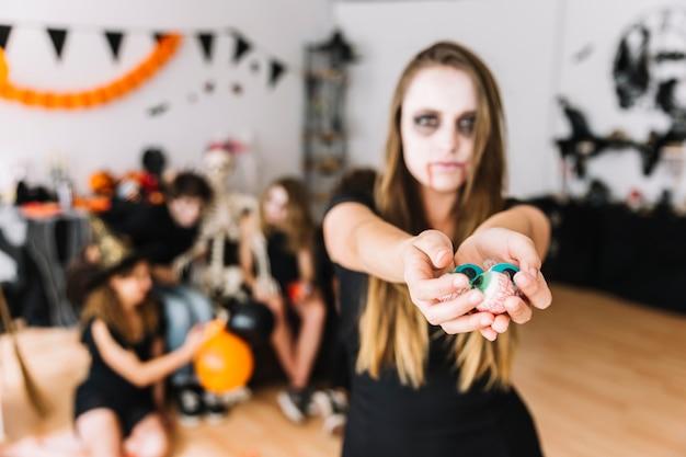 Teenage girl showing fake eyes