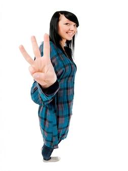 Teenage girl showing three fingers