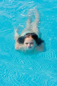 Teenage girl swims underwater