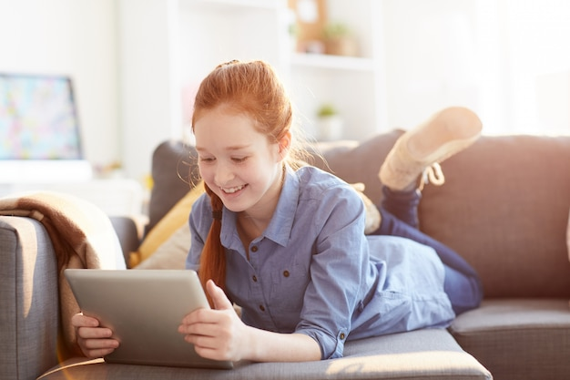 Teenage girl using tablet