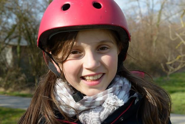 Teenage girl wearing a roller helmet.