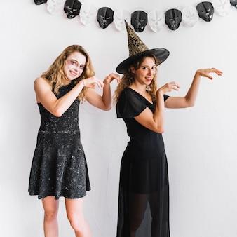 Teenage girls in halloween costumes acting like zombies