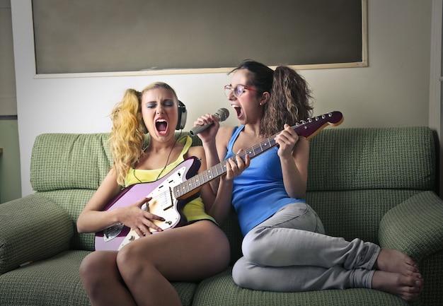 Teenage girls having fun at home