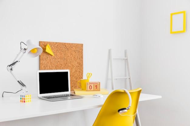 Teenage workplace with cork boardand headphones
