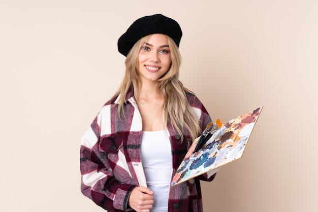 Teenager artist girl holding a palette