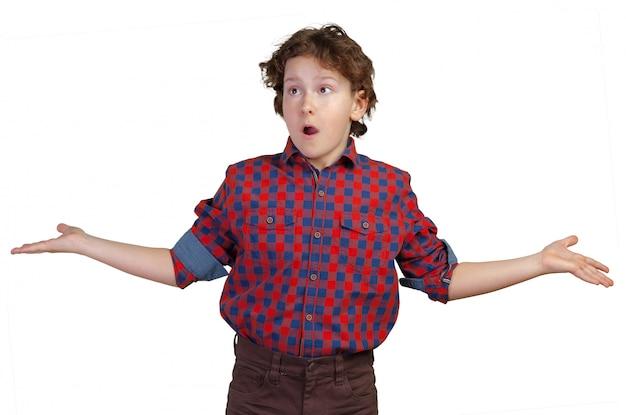 Teenager boy shrugs at a loss