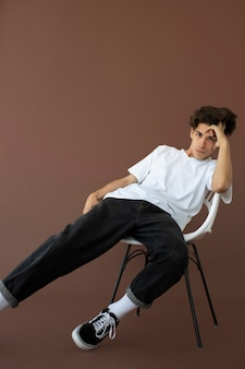 Teenager boy in stylish clothes posing