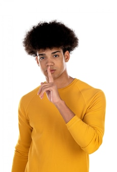 Teenager boy with afro hairstyle ordering silence
