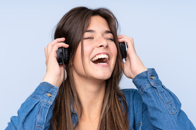 Teenager brazilian girl listening music and singing