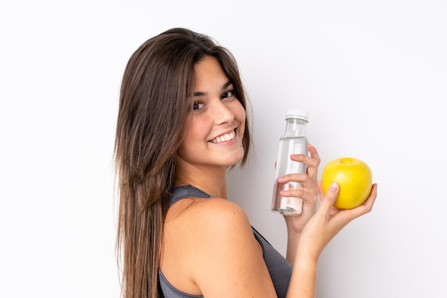 Teenager brazilian woman with an apple and a with a bottle of water