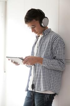 Teenager browsing tablet