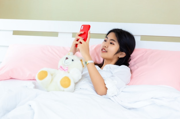 Teenager female use smartphone on the bed