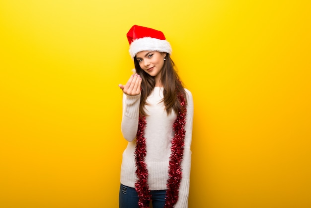 Teenager girl celebrating christmas holidays presenting and inviting to come
