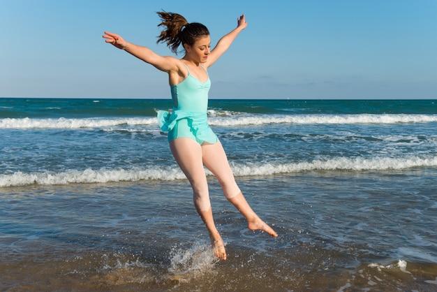 Teenager girl dancing outdoor