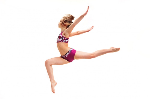 Teenager girl doing gymnastics exercises on white