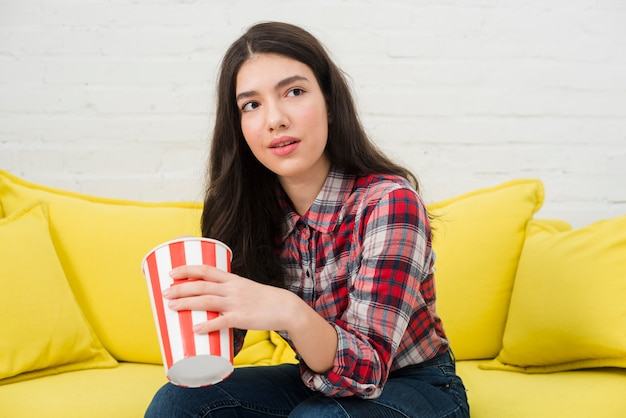 Teenager girl eating popcorn
