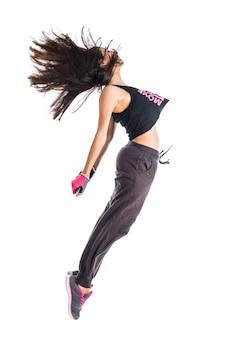 Подросток девочка прыгает в стиле хип-хоп