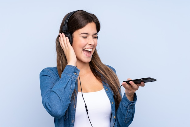 Teenager girl listening music and singing
