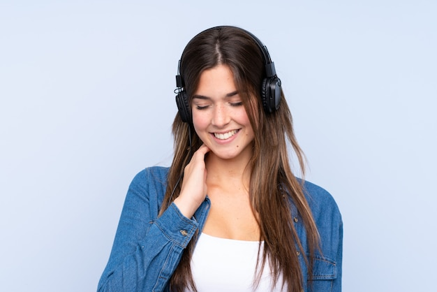 Teenager girl listening music