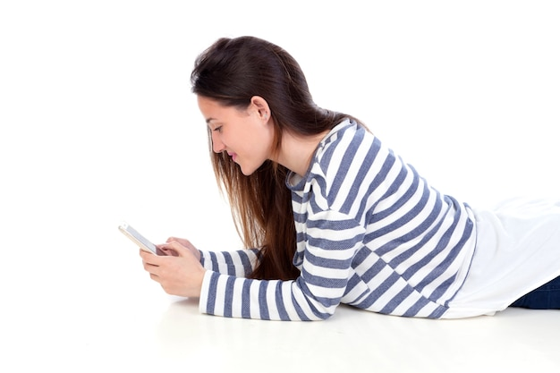 Teenager girl lying down looking the mobile