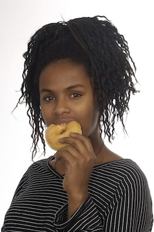 Teenager girl playing with a donut