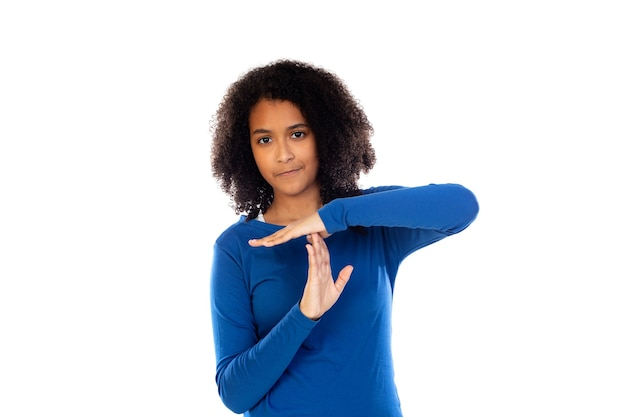 Teenager girl wearing blue sweater isolated on a white wall