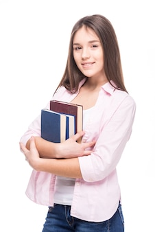 Teenager girl with books isolated on white
