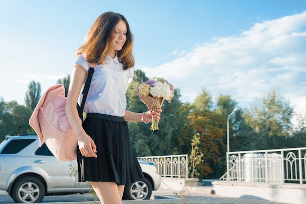 Teenager girl with bouquet of flowers