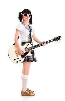 Teenager girl with a electric guitar