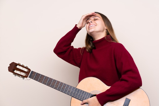Teenager girl with guitar has realized something and intending the solution