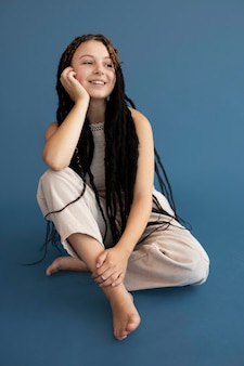 Teenager girl with hippie clothes and dreadlocks