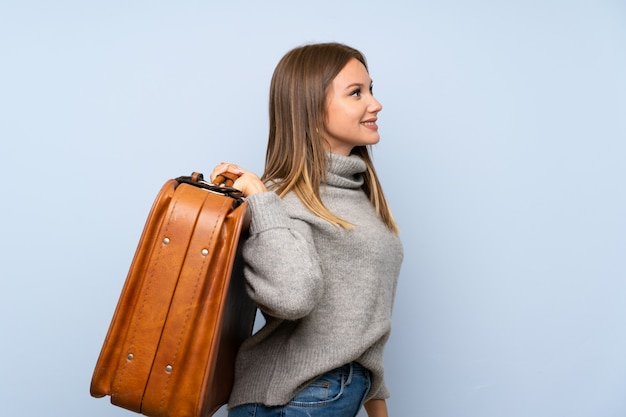 Teenager girl with sweater holding a vintage briefcase