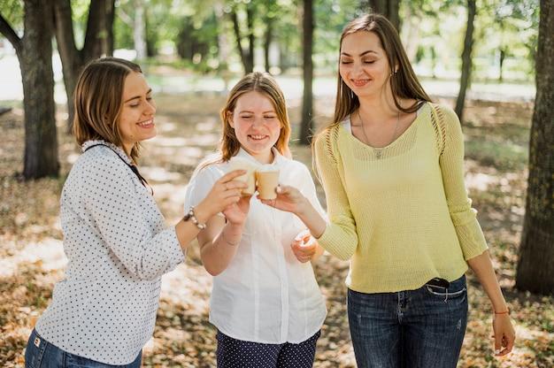 Teenager girls cheer with ice cream