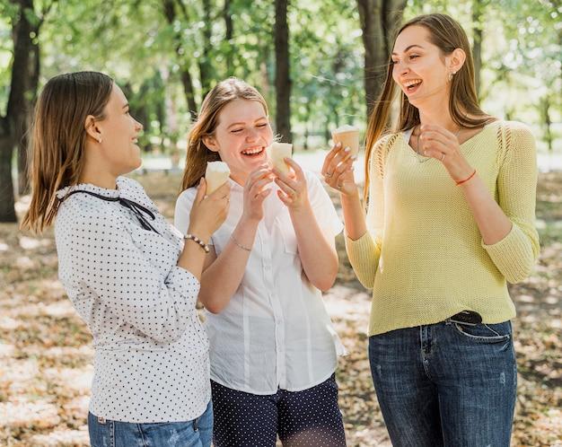 Teenager girls enjoying ice cream together