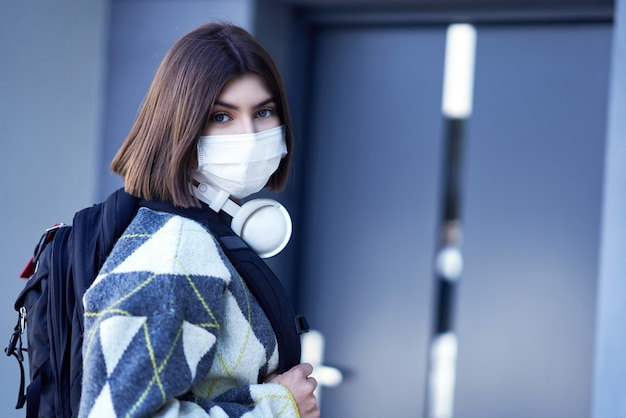 Teenager going to school with a mask on due to coronavirus pandemic