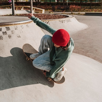Teenager having fun with skateboard at the park