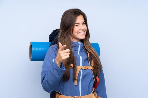 Teenager hiker girl points finger at you