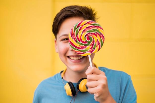 Teenager holding lolipop
